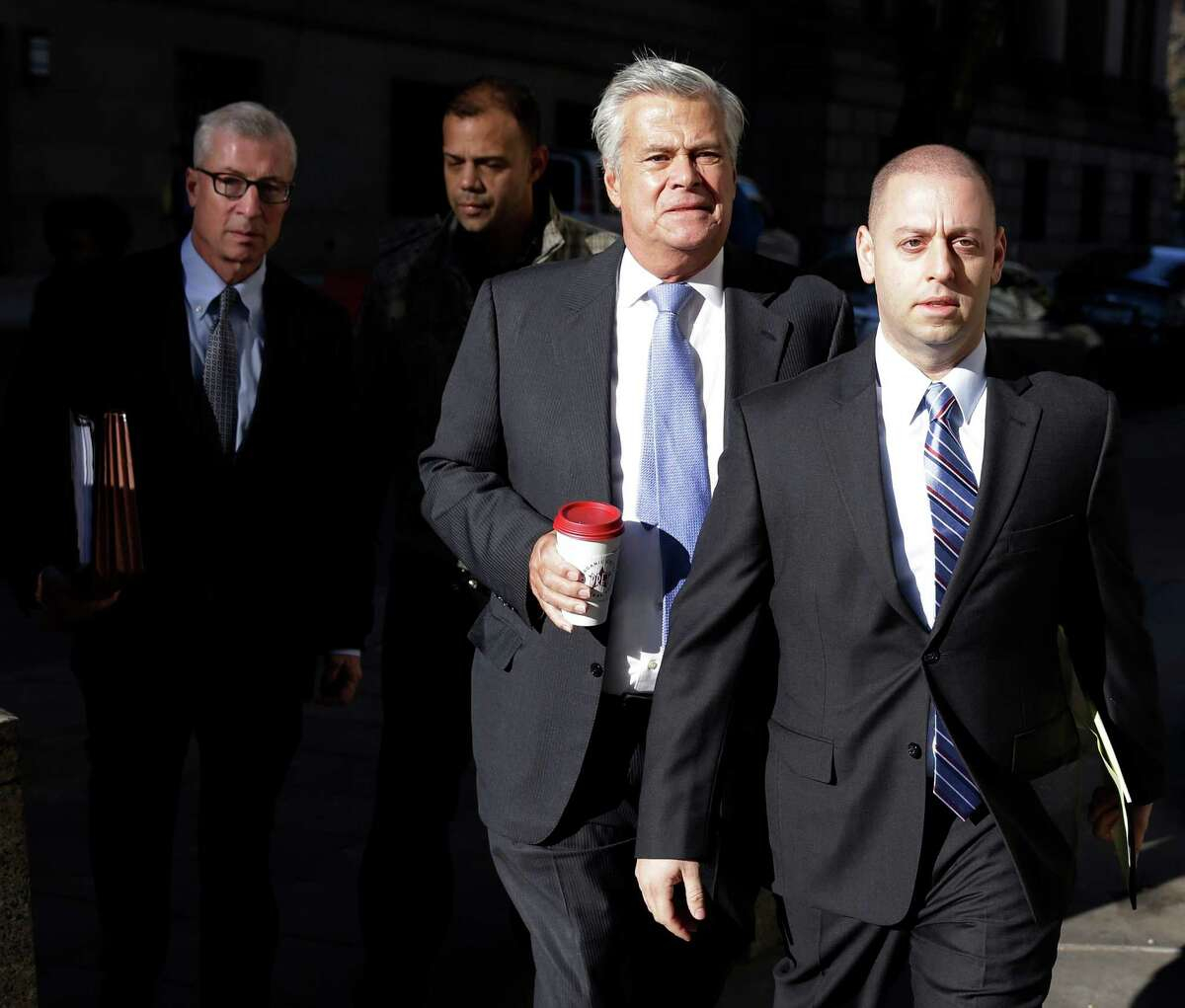 New York Sen. Dean Skelos, second from right, and his son Adam Skelos, right, arrive to court in New York, Tuesday, Nov. 17, 2015. Jury selection is expected to continue Tuesday in the corruption trial of Skelos, who is facing federal charges that he extorted bribes from companies with business before the state. (AP Photo/Seth Wenig) ORG XMIT: NYSW101