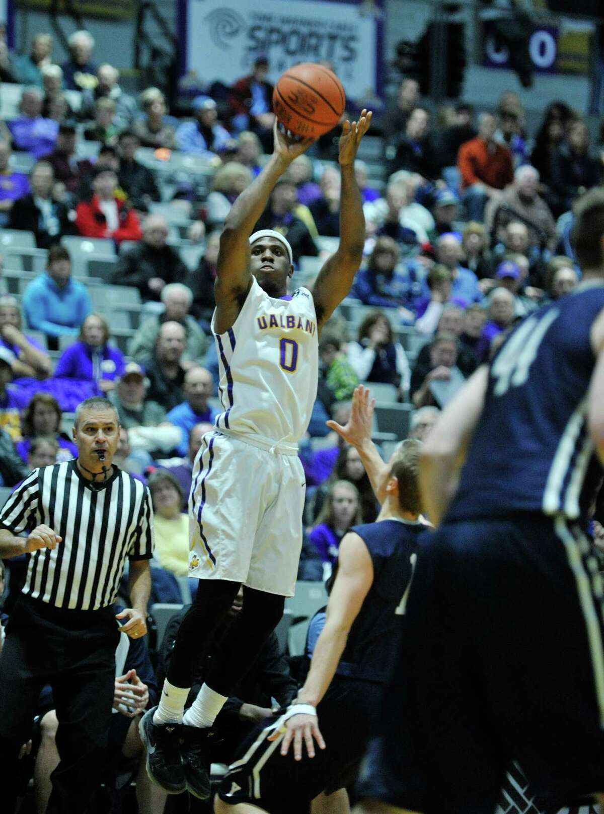 Evan Singletary of UAlbany puts up a three-pointer over a Yale player during their game on Sunday, Nov. 29, 2015, in Albany, N.Y. (Paul Buckowski / Times Union)