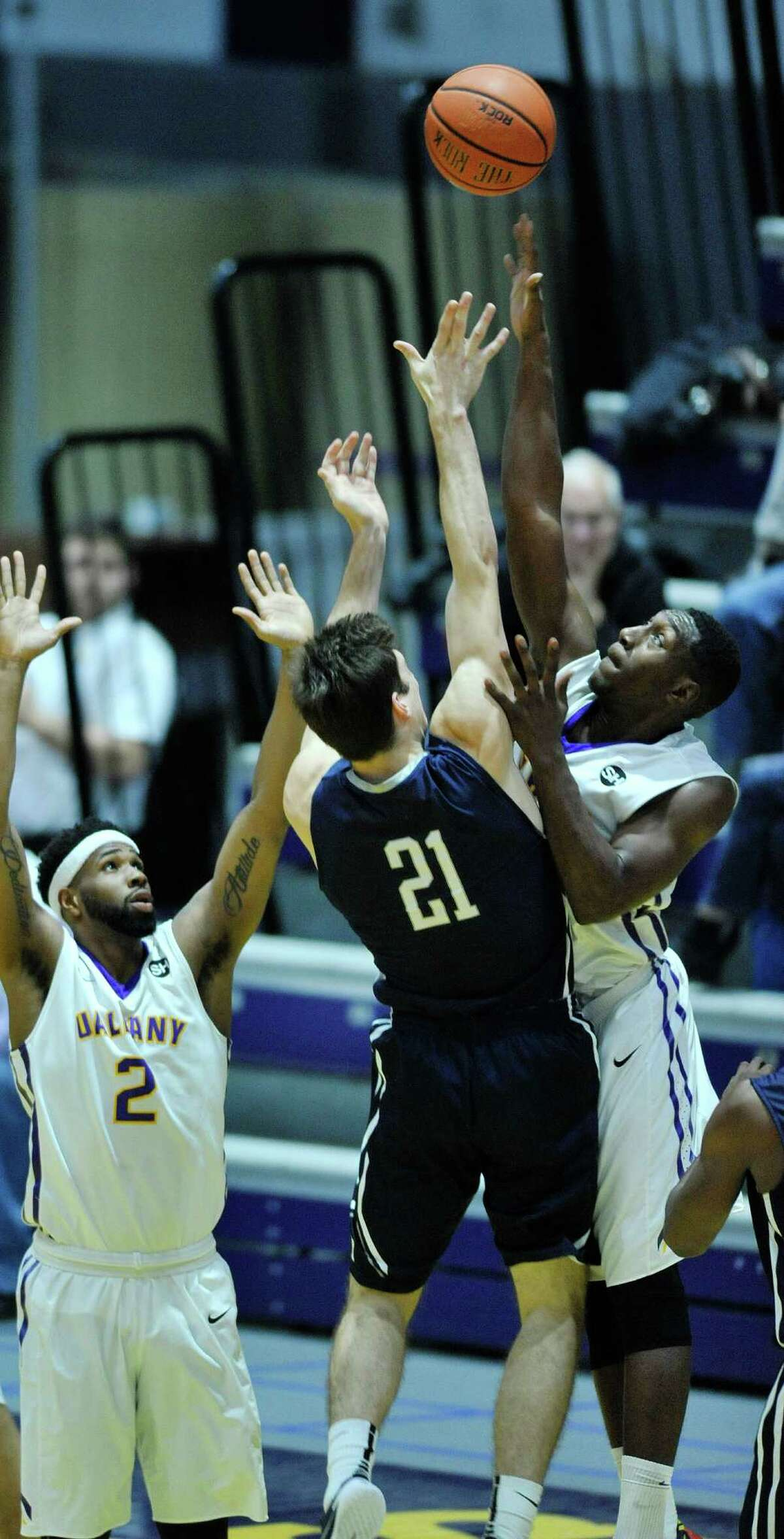 Nick Victor of Yale, left, puts up a shot over Travis Charles of UAlbany during their game on Sunday, Nov. 29, 2015, in Albany, N.Y. (Paul Buckowski / Times Union)