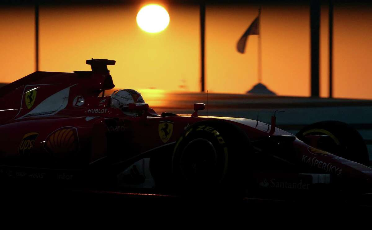 ABU DHABI, UNITED ARAB EMIRATES - NOVEMBER 29: Sebastian Vettel of Germany and Ferrari drives during the Abu Dhabi Formula One Grand Prix at Yas Marina Circuit on November 29, 2015 in Abu Dhabi, United Arab Emirates. (Photo by Paul Gilham/Getty Images) *** BESTPIX *** ORG XMIT: 528116795