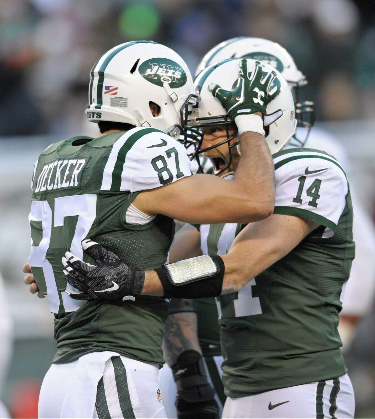 New York Jets quarterback Ryan Fitzpatrick (14) and Eric Decker (87) celebrate after the two connected for a touchdown during the second half of an NFL football game against the Miami Dolphins, Sunday, Nov. 29, 2015, in East Rutherford, N.J. (AP Photo/Bill Kostroun) ORG XMIT: ERU117