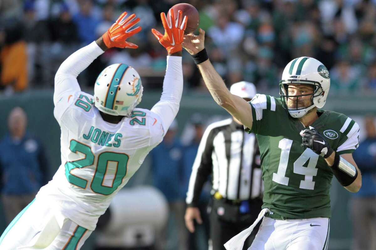 Miami Dolphins strong safety Reshad Jones (20) deflects a pass by New York Jets' Ryan Fitzpatrick (14) during the first half of an NFL football game Sunday, Nov. 29, 2015, in East Rutherford, N.J. (AP Photo/Bill Kostroun) ORG XMIT: ERU112