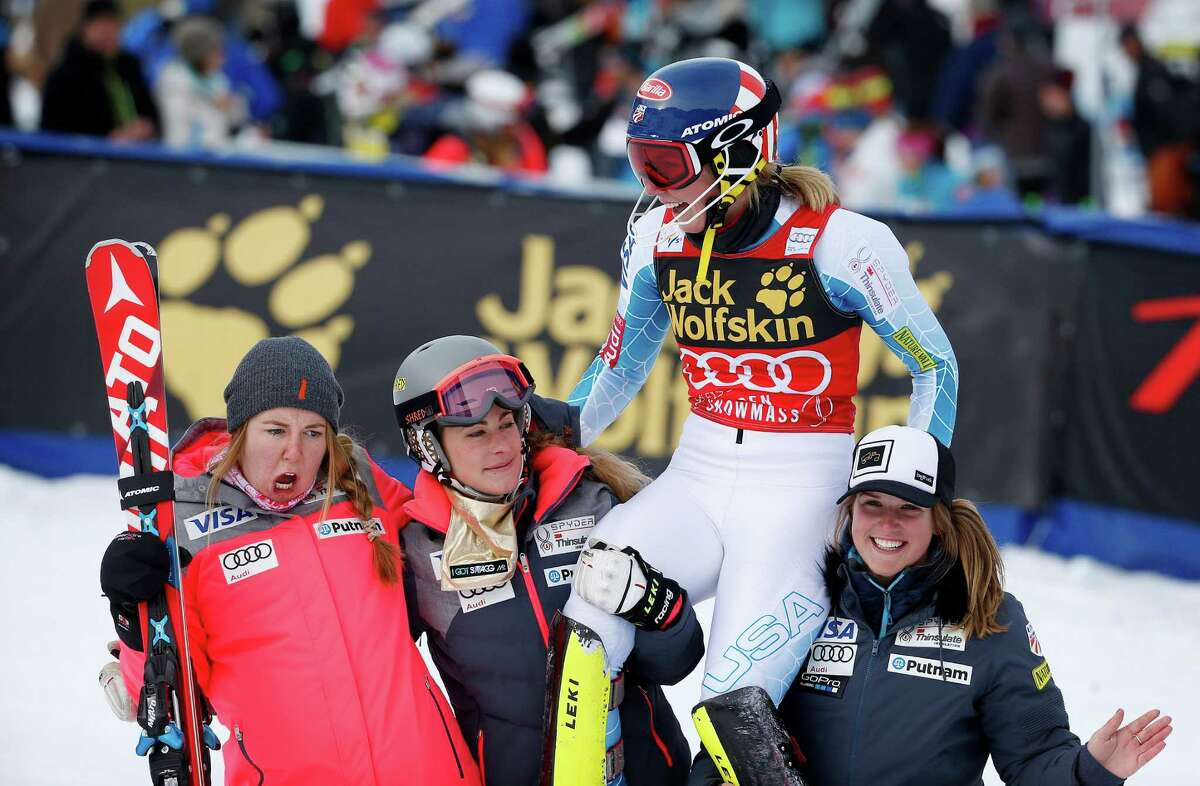 United States' Mikaela Shiffrin, second from right, celebrates after finishing her second run during the women's World Cup slalom ski race Sunday, Nov. 29, 2015, in Aspen, Colo. (AP Photo/Brennan Linsley) ORG XMIT: COJL124