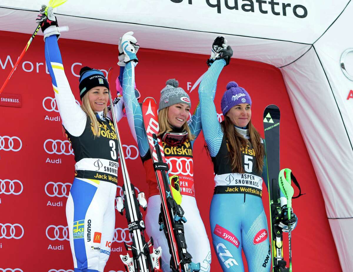 First place finisher United States' Mikaela Shiffrin, center, celebrates on the podium with second place finisher Sweden's Frida Hansdotter, left, and third place finisher Czech Republic's Sarka Strachova at the women's World Cup slalom ski race Sunday, Nov. 29, 2015, in Aspen, Colo. (AP Photo/Nathan Bilow) ORG XMIT: COJL128