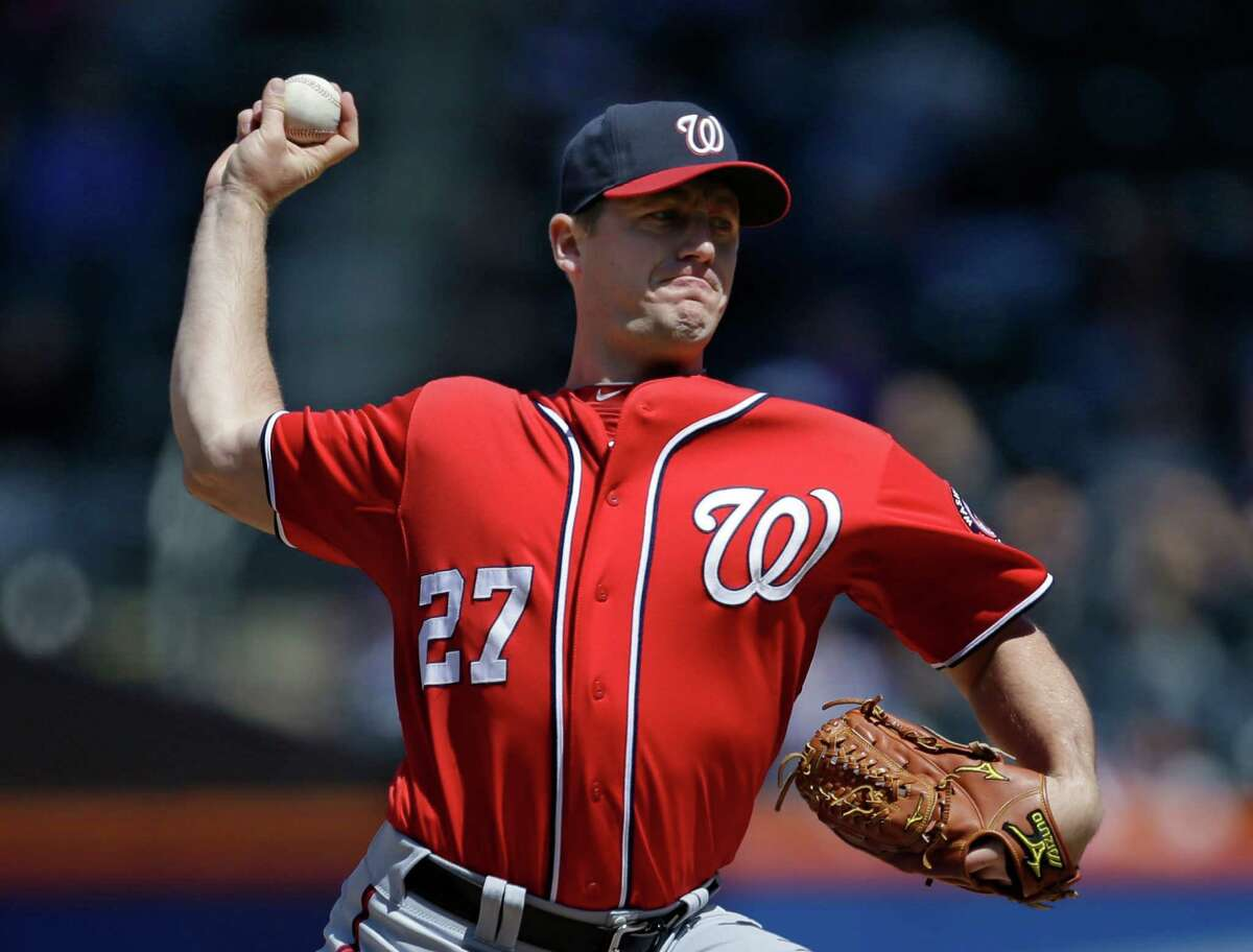 Washington Nationals starting pitcher Jordan Zimmermann delivers against the New York Mets in the first inning of a baseball game at Citi Field in New York, Sunday, April 21, 2013. (AP Photo/Kathy Willens)