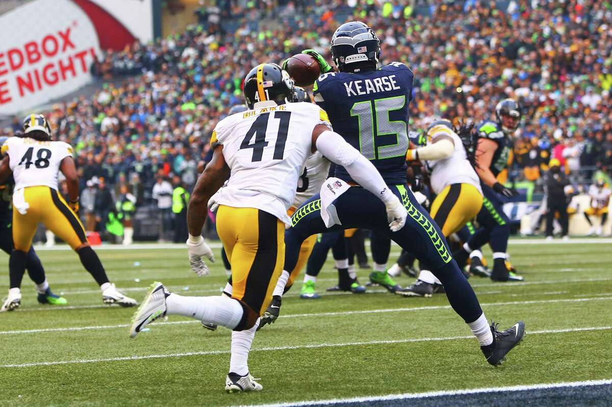 Seahawks' Jermaine Kearse (15) catches a 12-yard pass to score as Steelers' Antwon Blake (41) defends in the second quarter of Seattle's game against Pittsburgh, Sunday, Nov. 29, 2015.