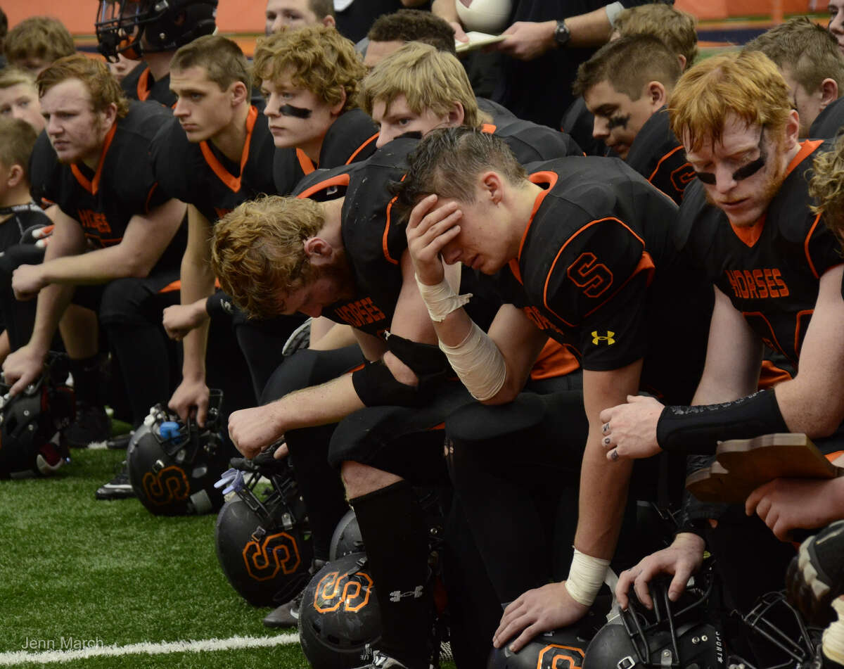 Schuylerville football players react to their loss to Cazenovia during the Class B State Championship, Sunday, Nov. 30, 2015, in Syracuse, N.Y. (Jenn March/Special to the Times Union)
