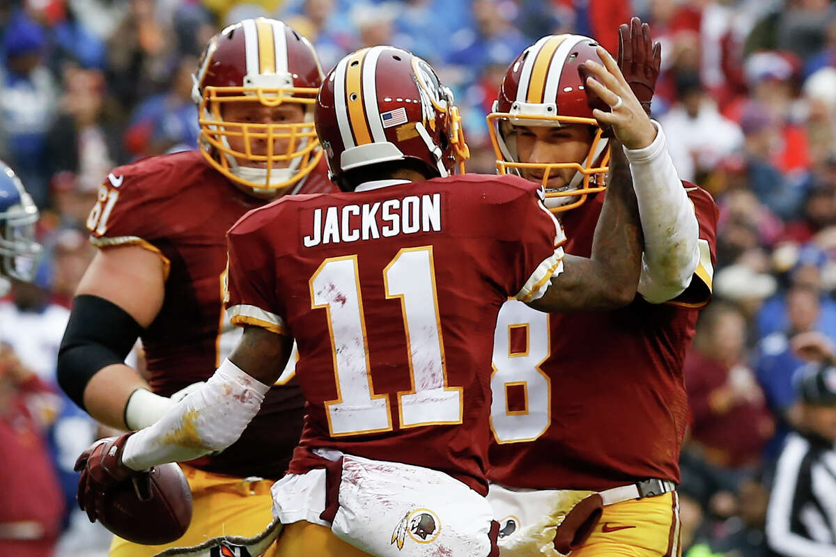 Washington Redskins wide receiver DeSean Jackson (11) celebrates his touchdown with quarterback Kirk Cousins (8) during the first half of an NFL football game against the New York Giants in Landover, Md., Sunday, Nov. 29, 2015. (AP Photo/Patrick Semansky) ORG XMIT: FDX106
