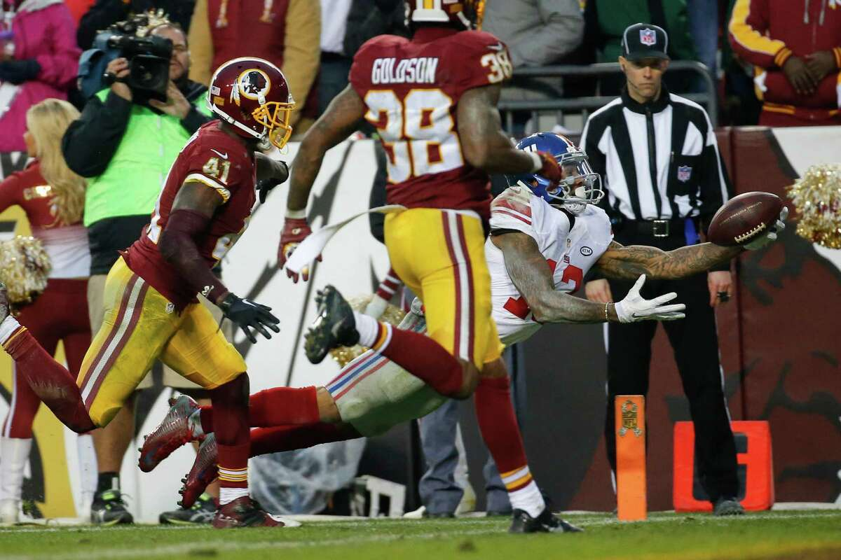 New York Giants wide receiver Odell Beckham (13) dives into the end zone for a touchdown as Washington Redskins cornerback Will Blackmon (41) and free safety Dashon Goldson (38) chase him during the second half of an NFL football game in Landover, Md., Sunday, Nov. 29, 2015. (AP Photo/Alex Brandon) ORG XMIT: FDX115