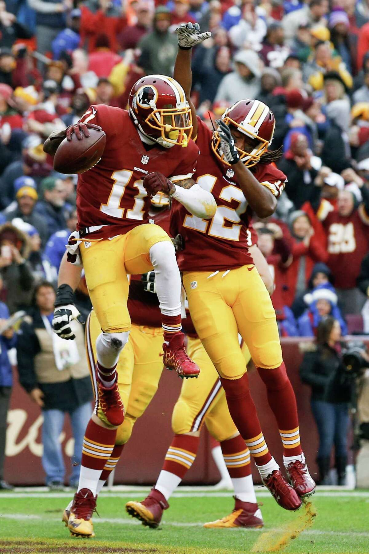 Washington Redskins wide receiver DeSean Jackson (11) celebrates his touchdown with wide receiver Andre Roberts (12) during the first half of an NFL football game against the New York Giants in Landover, Md., Sunday, Nov. 29, 2015. (AP Photo/Patrick Semansky) ORG XMIT: FDX105