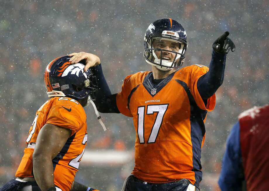 Denver Broncos quarterback Brock Osweiler (17) celebrates his touchdown pass to wide receiver Andre Caldwell, not seen, with Denver Broncos running back C.J. Anderson (22) during the second half of an NFL football game against the New England Patriots, Sunday, Nov. 29, 2015, in Denver. (AP Photo/Jack Dempsey) Photo: Jack Dempsey, Associated Press