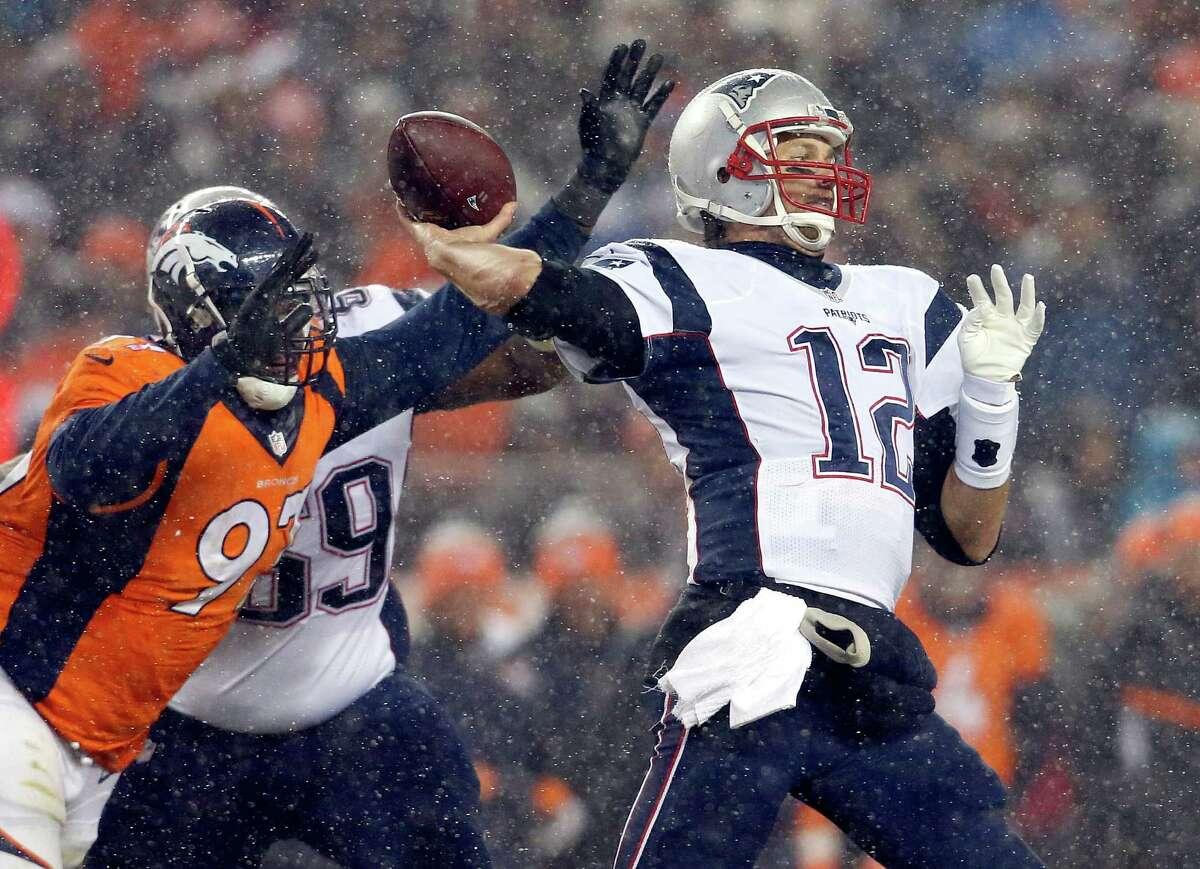 New England Patriots quarterback Tom Brady (12) throws against the Denver Broncos during the second half of an NFL football game, Sunday, Nov. 29, 2015, in Denver. (AP Photo/Joe Mahoney) ORG XMIT: COMY143