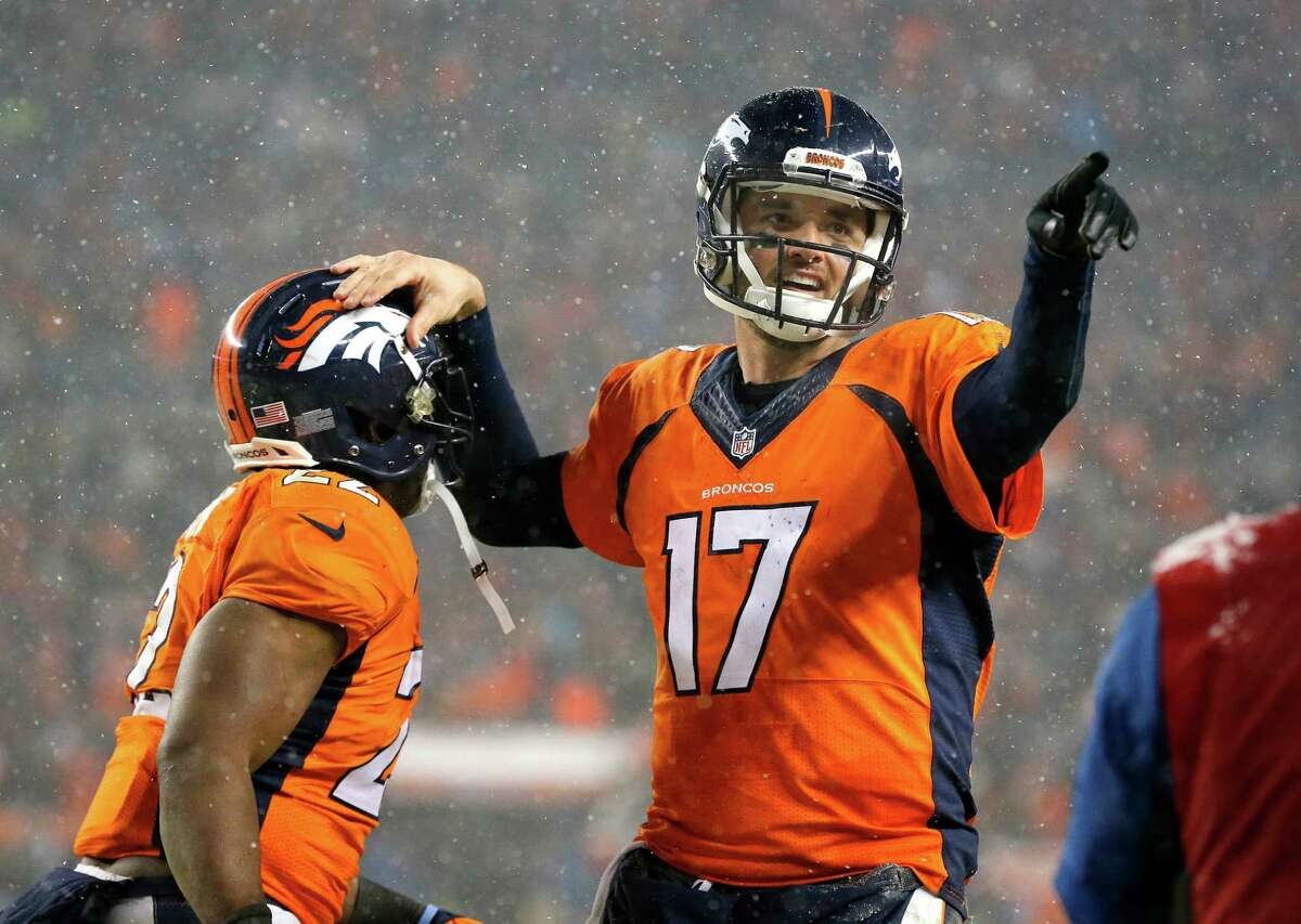 Denver Broncos quarterback Brock Osweiler (17) celebrates his touchdown pass to wide receiver Andre Caldwell, not seen, with Denver Broncos running back C.J. Anderson (22) during the second half of an NFL football game against the New England Patriots, Sunday, Nov. 29, 2015, in Denver. (AP Photo/Jack Dempsey) ORG XMIT: COMY152
