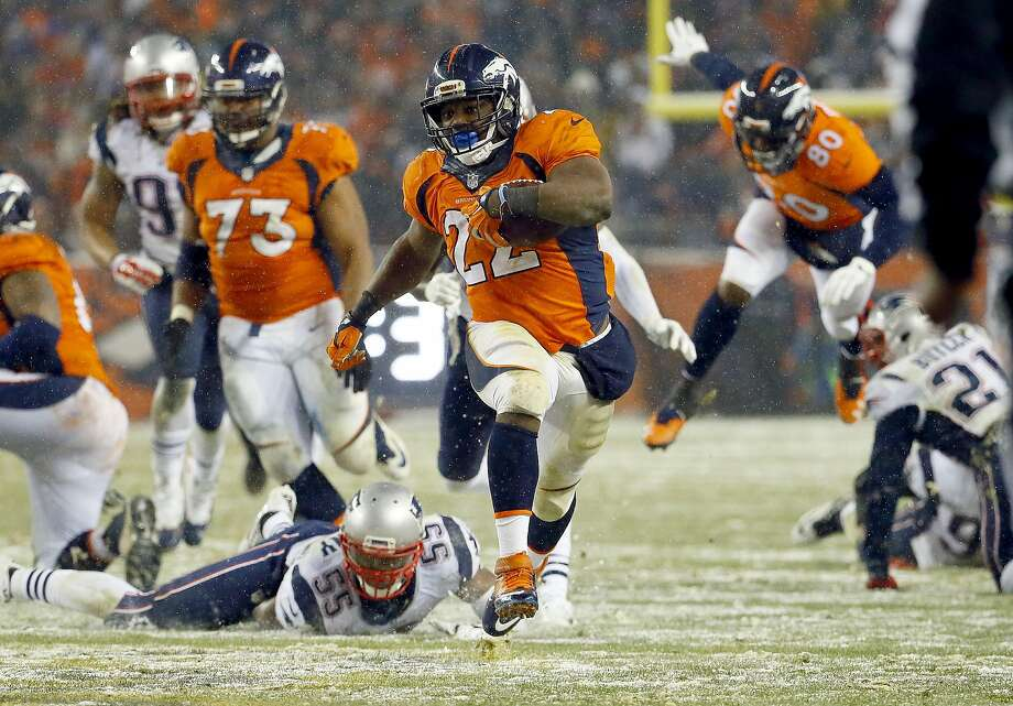 Broncos running back C.J. Anderson breaks free to score the winning touchdown in overtime. Photo: Jack Dempsey, Associated Press