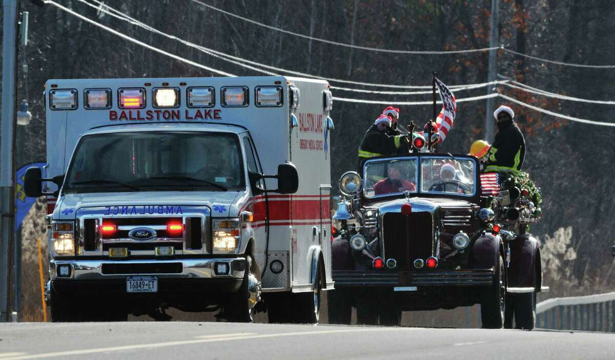 An ambulance crew and firefighters in a truck head north on Route 9 as part of the 2015 Convoy for Tots, a Toys for Tots event, on Sunday, Nov. 29, 2015, in Clifton Park, N.Y. The event is held to call attention to the Toys for Tots program and to gather unwrapped toys for needy children. (Paul Buckowski / Times Union)