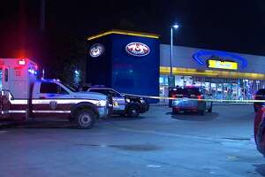 Police: Woman shot, dumped at store - Photo