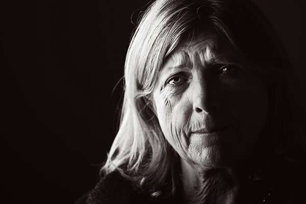 Studio portrait of sad woman