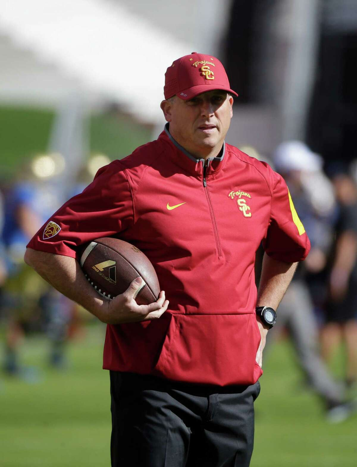 Southern California interim head coach Clay Helton watches his players warm up before an NCAA college football game against UCLA Saturday, Nov. 28, 2015, in Los Angeles. (AP Photo/Jae C. Hong)