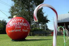 A large ornament wishing passers-by Christmas wishes from the City of Nederland sits among the decorations in Tex Ritter Park. The city is also selling Nederland-themed ornaments. Photo taken Wednesday, November 25, 2015 Kim Brent/The Enterprise