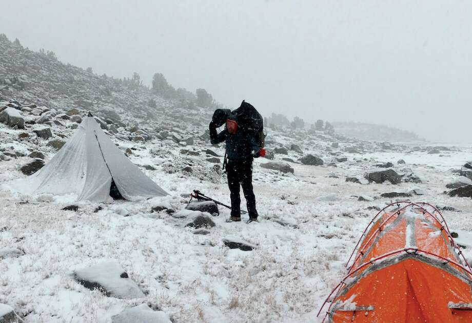 The Chronicle's Tom Stienstra wakes up to blizzard at camp at 12,000 feet in high country of Yosemite National Park above Donohue Pass near Sierra Crest below Mount Lyell. Photo: Braden Mayfield, Special To The Chronicle