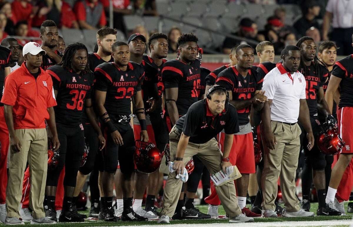 Houston Cougars head coach Tom Herman watches the game from the sidelines in the second half of game action against Vanderbilt on Saturday, Oct. 31, 2015, in Houston. Houston won the game 34-0. ( Elizabeth Conley / Houston Chronicle )