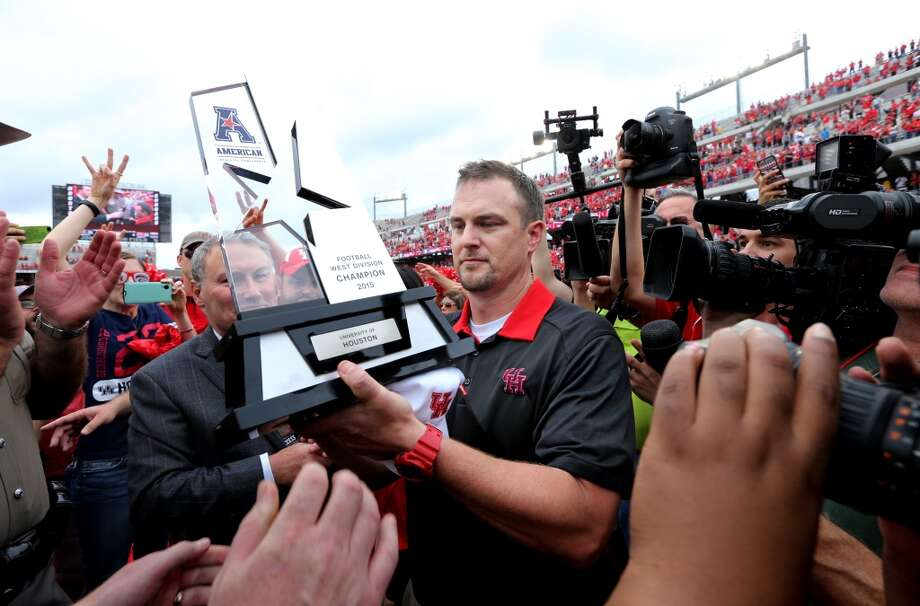 After leading his team to the AAC West Division championship, UH coach Tom Herman was named the AAC co-coach of the year Wednesday.Click through the gallery for a timeline of Herman's UH tenure. Photo: Houston Chronicle