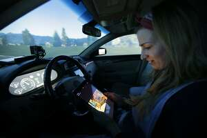 In self-driving cars, distractions found to keep operators alert - Photo