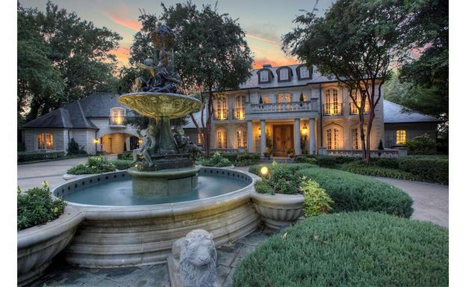 This home in Heath, just east of Dallas, is on the market for $5.75 million. The three-story home includes six bedrooms, a wine cellar and two guest quarters. Photo: Courtesy, Dee Evans Of Ebby Halliday Realtors