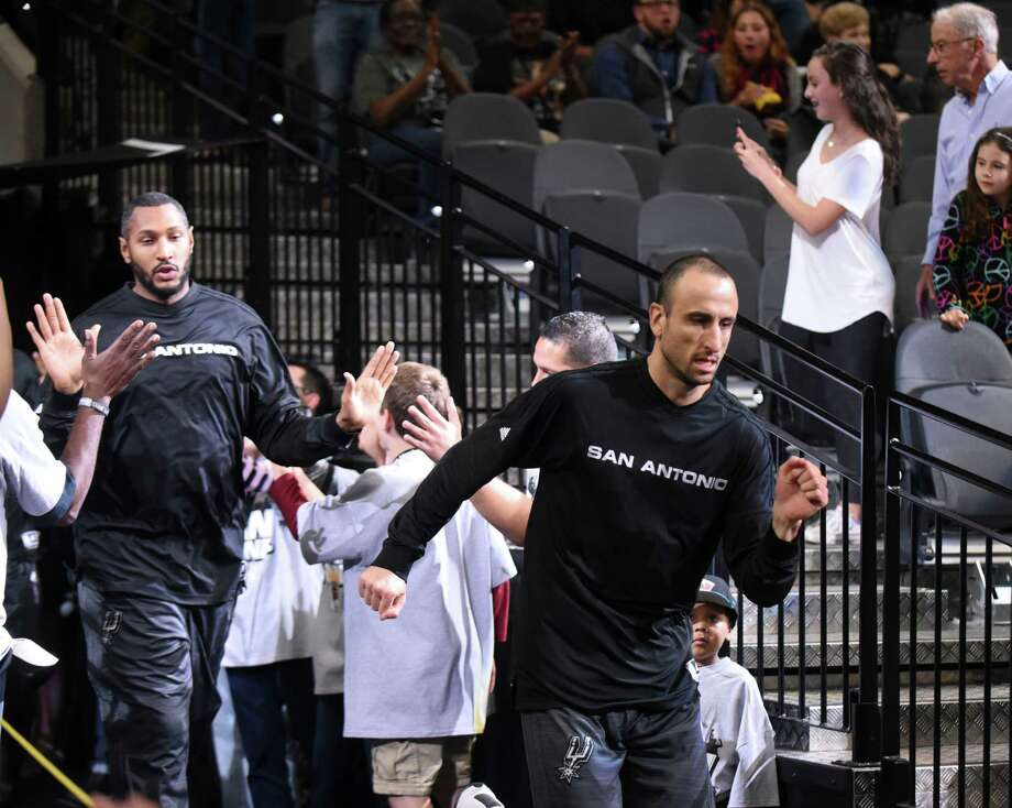 Veteran guard Manu Ginobili of the San Antonio Spurs enters the court for the team's game against the Dallas Mavericks at the AT&T Center on Wednesday, Nov. 25, 2015. Photo: Billy Calzada, Staff / San Antonio Express-News / San Antonio Express-News
