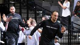 Veteran guard Manu Ginobili of the San Antonio Spurs enters the court for the team's game against the Dallas Mavericks at the AT&T Center on Wednesday, Nov. 25, 2015.