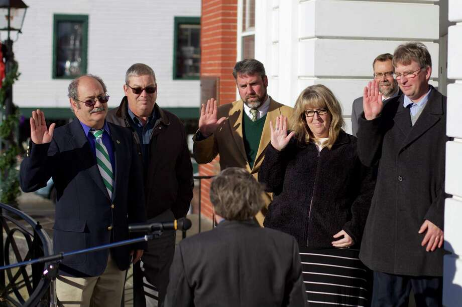Judge Marty Landgrebe swears in David Lawson, Bill Dahl, Jason Schemm, Tammy McInerney, Brian McCauley for the Board of Education on the steps of Town Hall in New Milford on Sunday, Nov. 29th at 2:00pm. Photo: Trish Haldin / For Hearst Connecticut Media / The News-Times Freelance