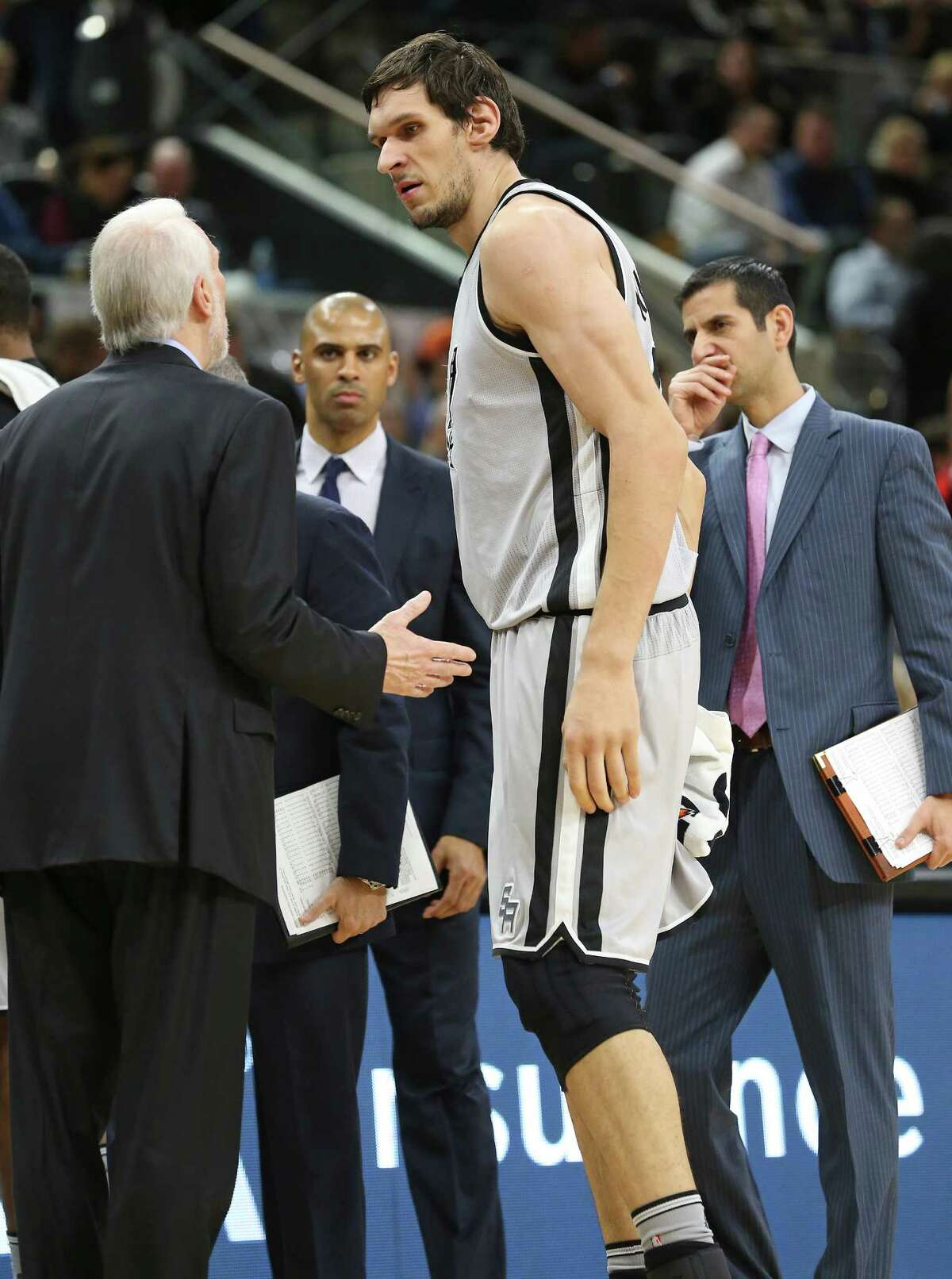 Coach Gregg Popovich confronts Boban Marjanovic during a time out as the Spurs play the Atlanta Hawks at the AT&T Center on November 28, 2015.