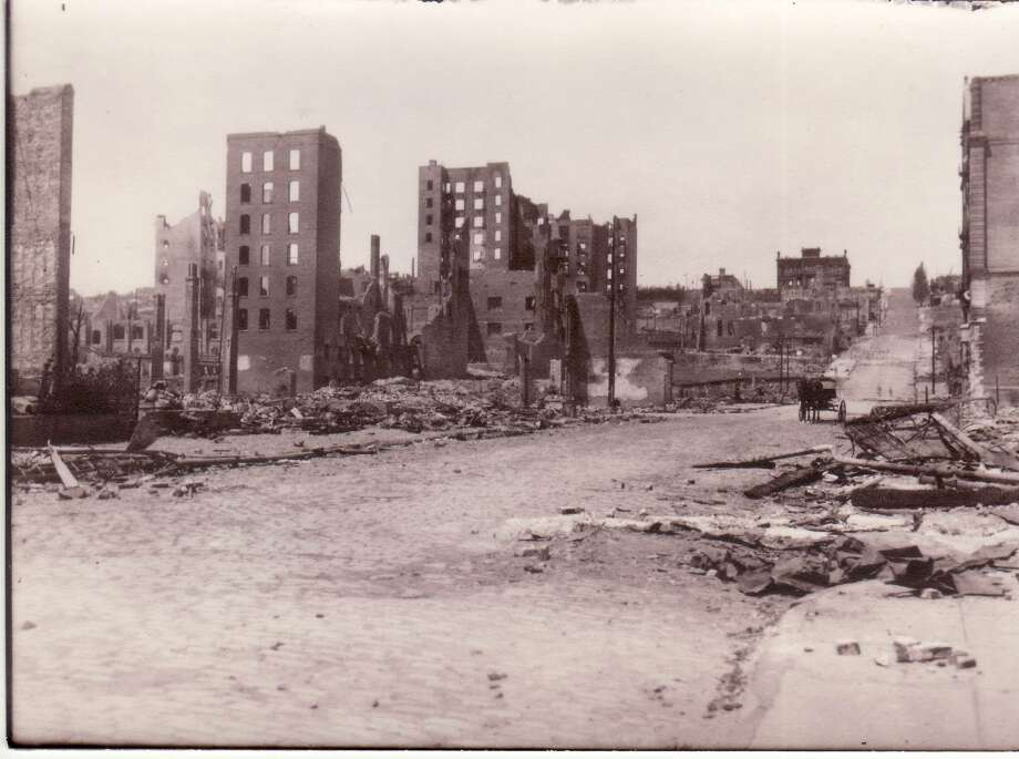 This photo was taken by John Ashley Tyson, a survivor of the 1906 San Francisco earthquake, and original owner of the book. From the original glass negative. Courtesy of Terri L. Roberts (Tyson). The exact location was unknown. This photo is looking north on Mason Street from around Geary Street.  The building on the