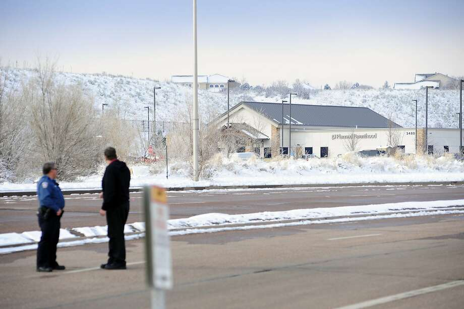 Law enforcement agencies continue the investigation Sunday, Nov. 29, 2015, in Colorado Springs, Colo., after Friday's deadly shooting at a Planned Parenthood clinic. (Daniel Owen/The Gazette via AP) MAGS OUT; MANDATORY CREDIT Photo: Daniel Owen, Associated Press