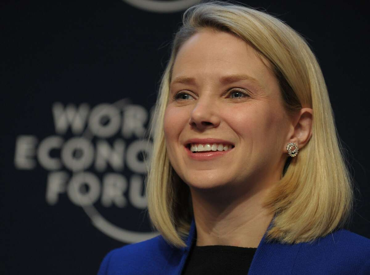 """(FILES) This January 22, 2014 file photo shows Yahoo CEO Marissa Mayer as she takes part in the session """"the new digital context"""" on the opening day of the World Economic Forum in Davos. Lack of a long-awaited turnaround at Yahoo has put pressure on chief executive Marissa Mayer to prove she has what it takes to revive the faded Internet pioneer. Investors, who were already disappointed by low momentum under Mayer, were given more to worry about this week. A hedge fund with a stake in Yahoo urged the Internet giant on November 19, 2015 to drop its planned spin off of its holdings in China's Alibaba. AFP PHOTO ERIC PIERMONT ERIC PIERMONT/AFP/Getty Images"""