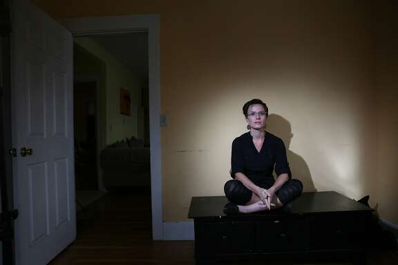 Sarah Shourd, of Oakland, sits for a portrait in her home on Monday, November 30,  2015 in Oakland, Calif.