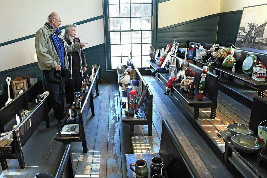 Angelo and Claire Dounoucos of Delmar shop at the Christmas craft fair at the Shaker Heritage Society on Monday, Nov. 30, 2015 in Albany, N.Y. (Lori Van Buren / Times Union) Photo: Lori Van Buren