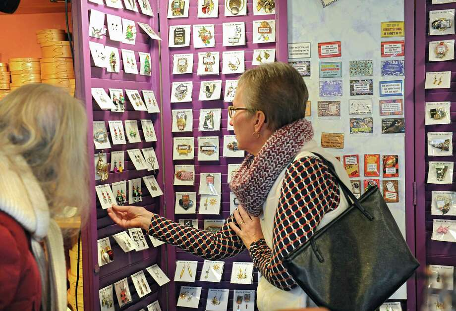 Bernie Walman of Schodack, left, and her friend Beth Secor of Schodack shop at the Christmas craft fair at the Shaker Heritage Society on Monday, Nov. 30, 2015 in Albany, N.Y. (Lori Van Buren / Times Union) Photo: Lori Van Buren