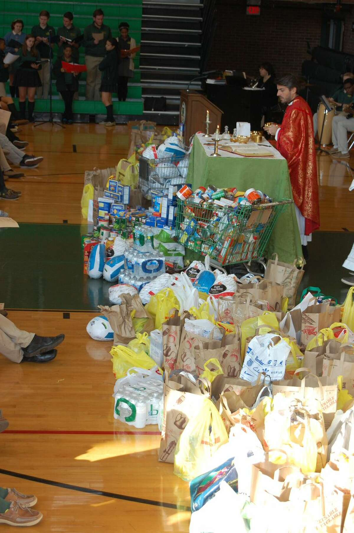 Trinity Catholic High School blessed more than two tons of donated food at its annual Thanksgiving Mass.