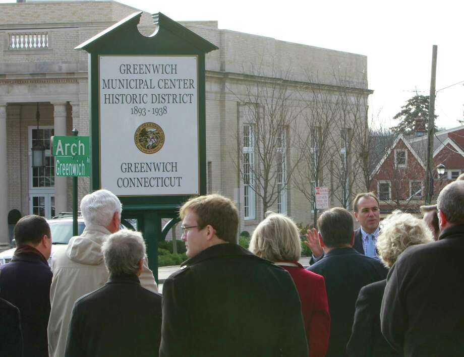 First Selectman Peter Tesei, at right, on Monday dedicates a marker declaring the Greenwich Municipal Center Historic District . This is the first of nine markers that will go up naming historic parts of town. Photo: Matthew Brown / For Hearst Connecticut Media / Connecticut Post Freelance