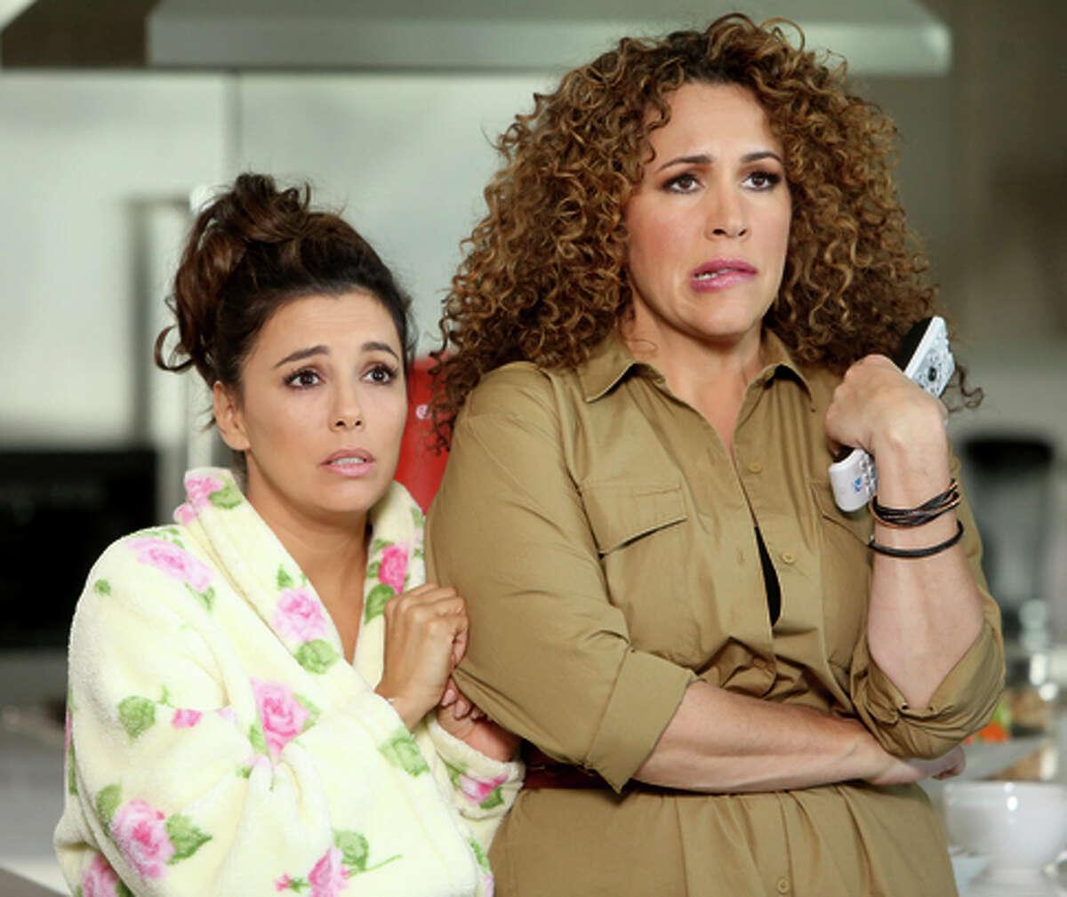 Eva Longoria as Ana Sofia Calderon (left), Diana Maria Riva as Mimi in