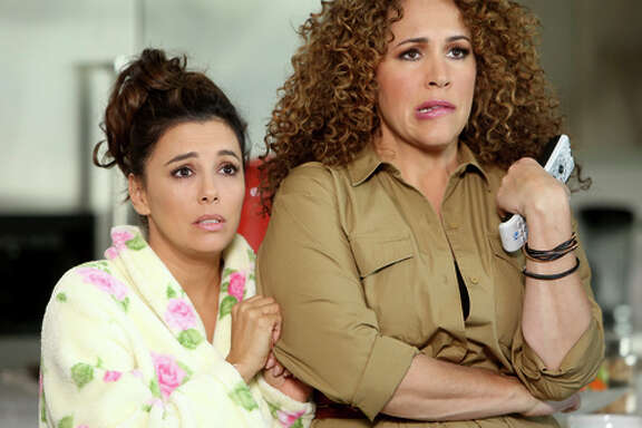 "Eva Longoria as Ana Sofia Calderon (left), Diana Maria Riva as Mimi in ""Telenovela."""