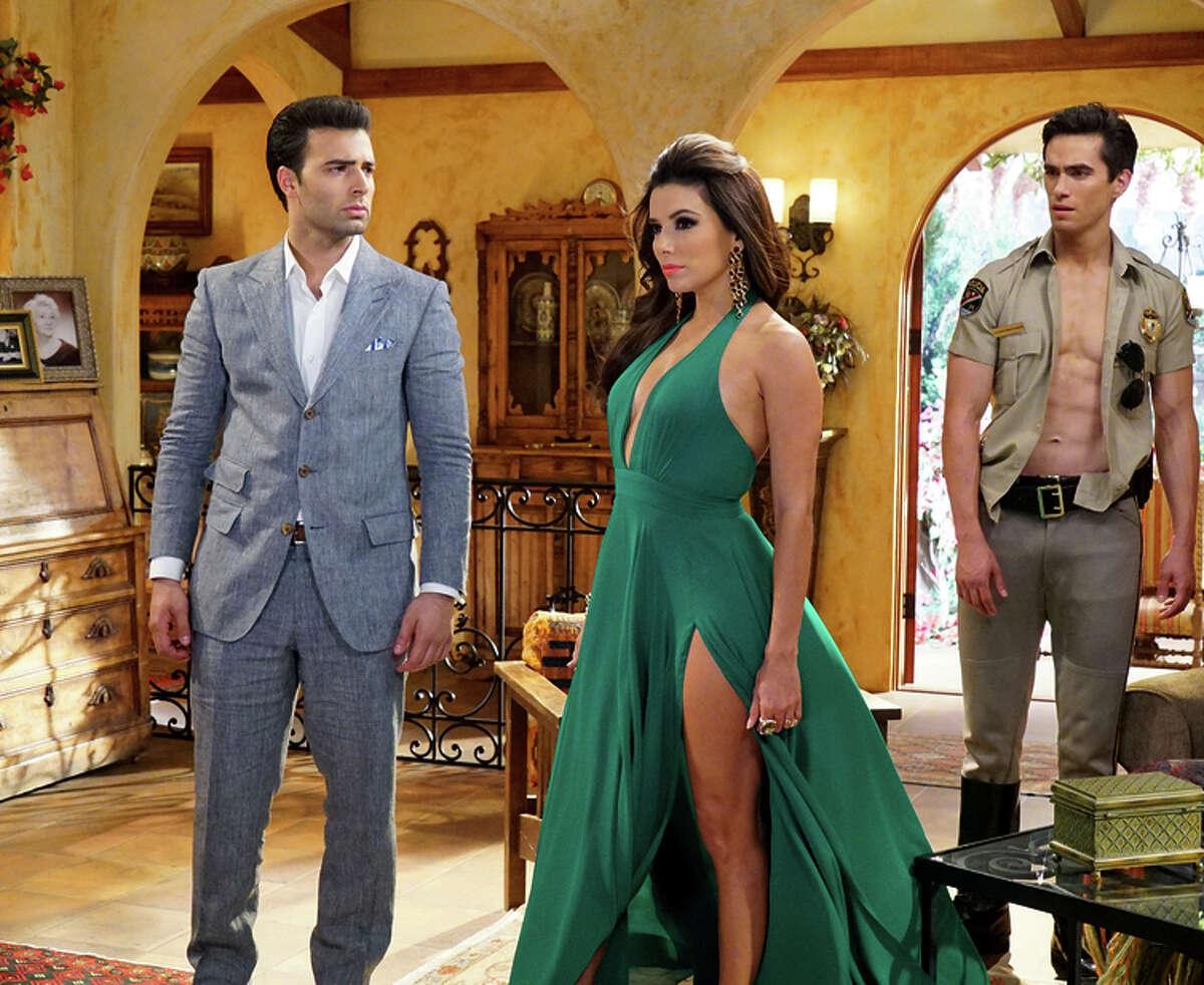 Jencarlos Canela (left) as Camilo, Eva Longoria as Pasion, Jose Moreno Brooks as Cesar.