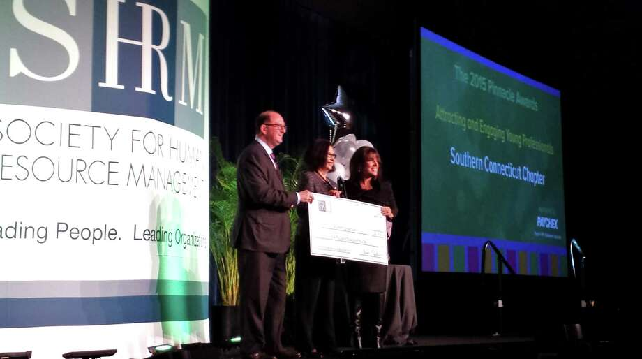 Susan Blazer, president for the Southern Connecticut chapter of the Society of Human Resource Management, accepts the 2015 SHRM Pinnacle Award for an exceptional HR program from SHRM representatives at an award ceremony in Washington, D.C. Photo: Contributed