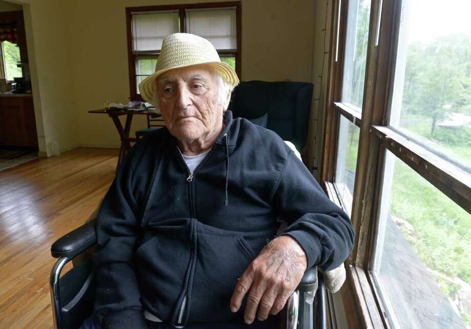 Lou Russo, 96, sits in his New Fairfield, Conn, home on Wednesday, May 20, 2015. Russo, a World War II veteran, was put in a nursing home by a court-order conservator, who also spent his life savings and rented his home to others. Russo got good news in probate court, the conservator has been ordered to pay him $34,000. Photo: H John Voorhees III / H John Voorhees III / The News-Times