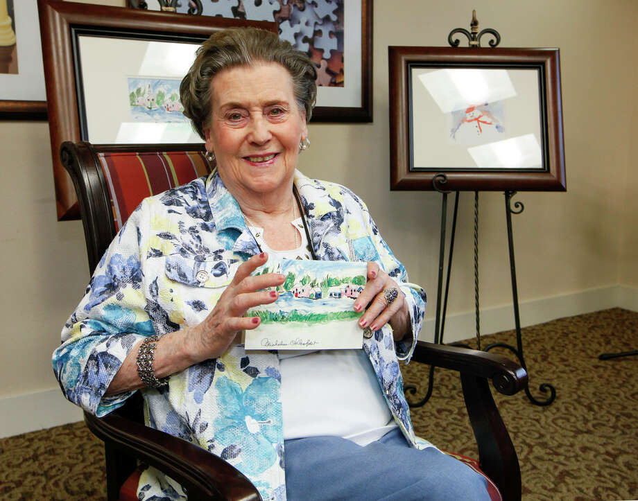 "Micheline ""Mickey"" Ohlenforst, a resident at the Franklin Park Stone Oak Assisted Living facility, with the Christmas card from the local chapter of the Alzheimer's Association featuring a snow scene she painted, on Dec. 9, 2013. Photo: Marvin Pfeiffer /San Antonio Express-News / Express-News 2013"