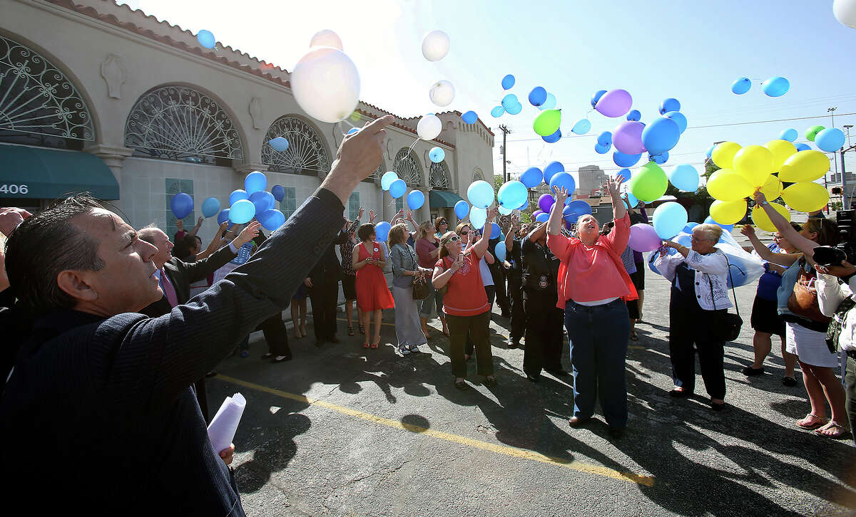 State Senator Carlos Uresti leads the ceremony as CASA and the Blue Ribbon Task Force are joined by child advocacy groups and community members in releasing balloons to honor victims of abuse on April 30, 2014.