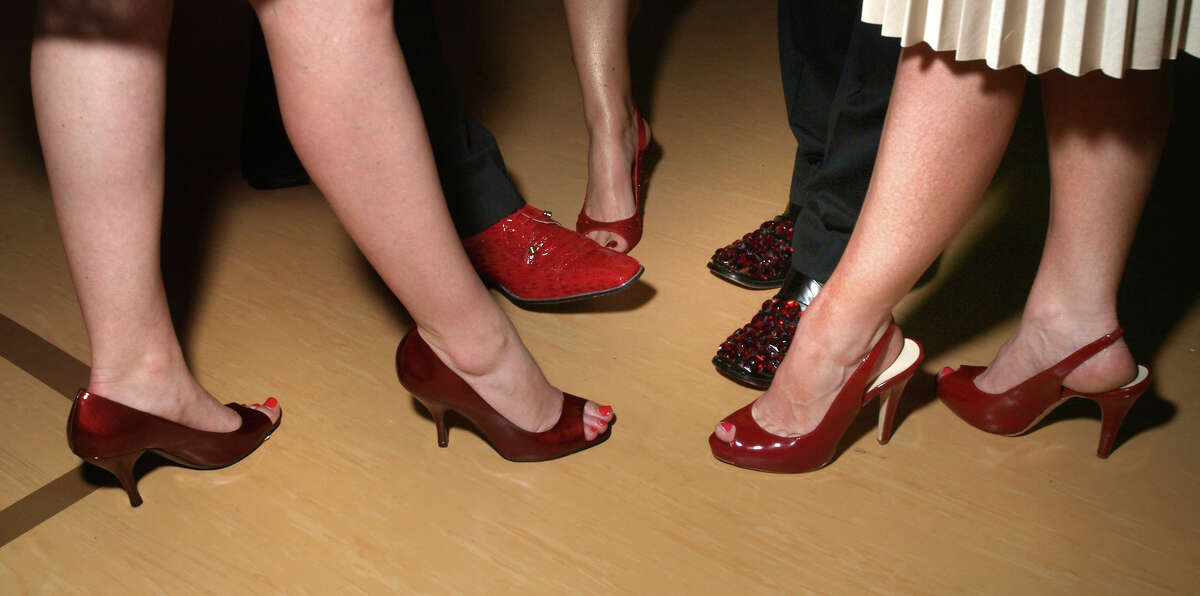 Participants at the 2009 Red Shoes Gala at St. P J's get show us their shoes. Next year's event will be in March.