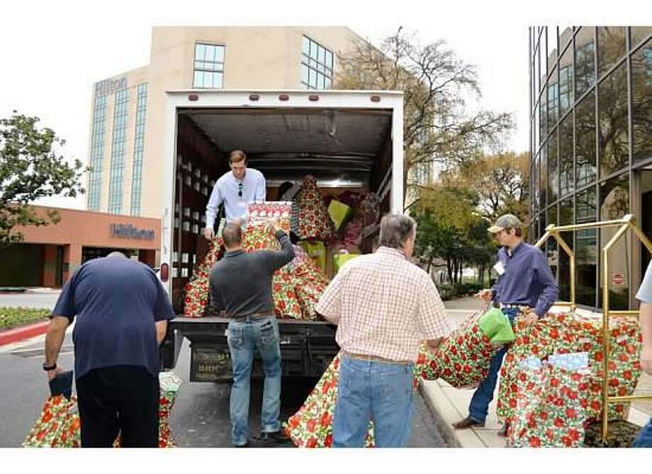 Christy's Hope supporters load Christmas presents destined for the Battered Women and Children Shelter in 2014. They are (from left) Kirk Jorgensen, Rane Pearson (in truck), Jeff Eigel, Jace Pearson and Colt Pearson. Photo: Courtesy Christy's Hope