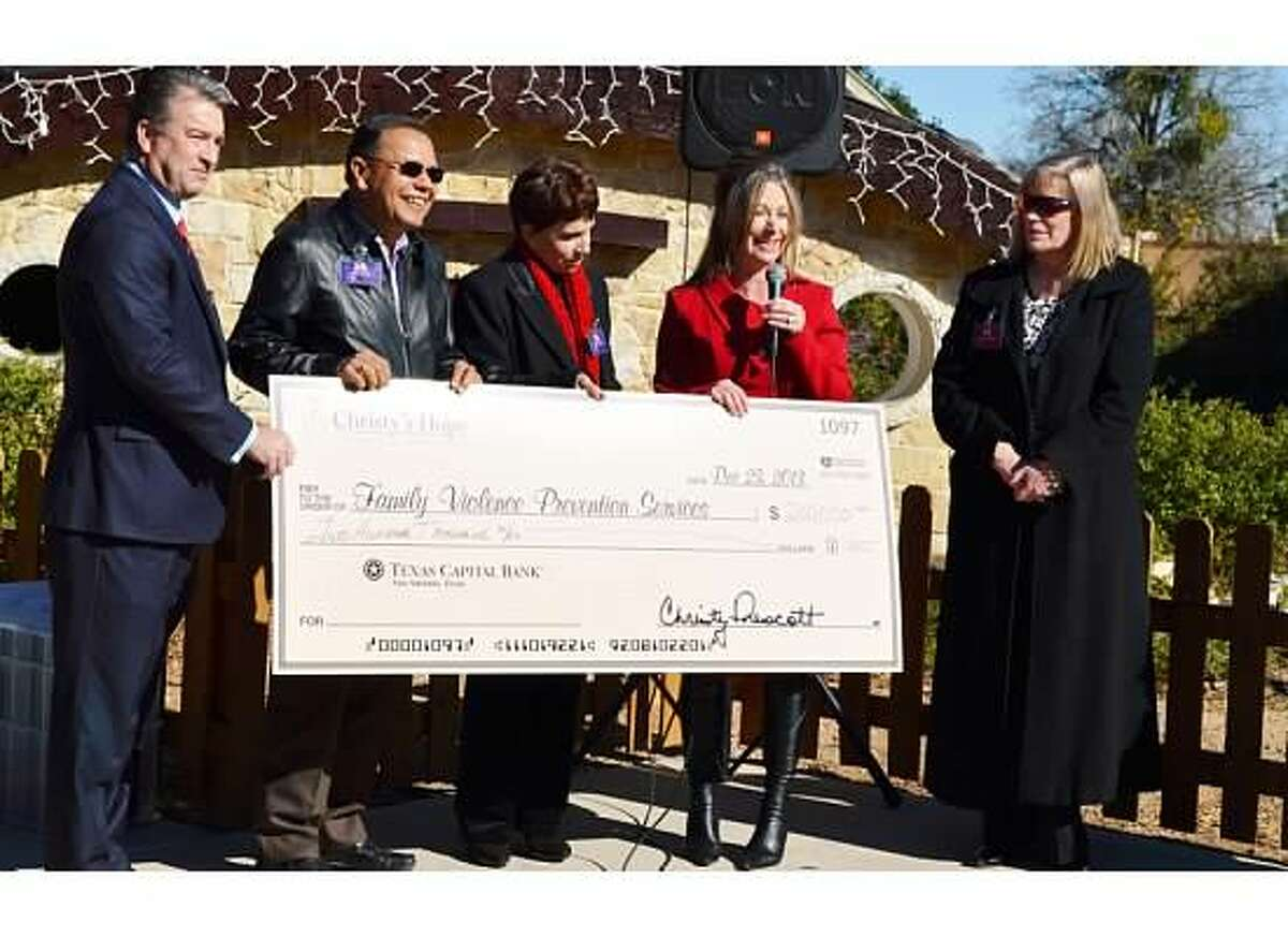 Christy's Hope founder Christy Prescott (second from right) presents a donation in December 2014 to Family Violence Prevention Services. Also pictured are (from left) Clay Jett, Ron Acosta, Marta Peláez (president and CEO of the organization) and Cindy Jorgensen.